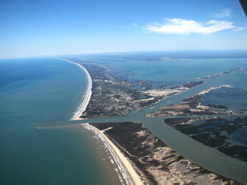 St jo island in foreground and port aransas across the for Port a texas